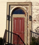 This doorway has welcomed visitors throughout for over a century.